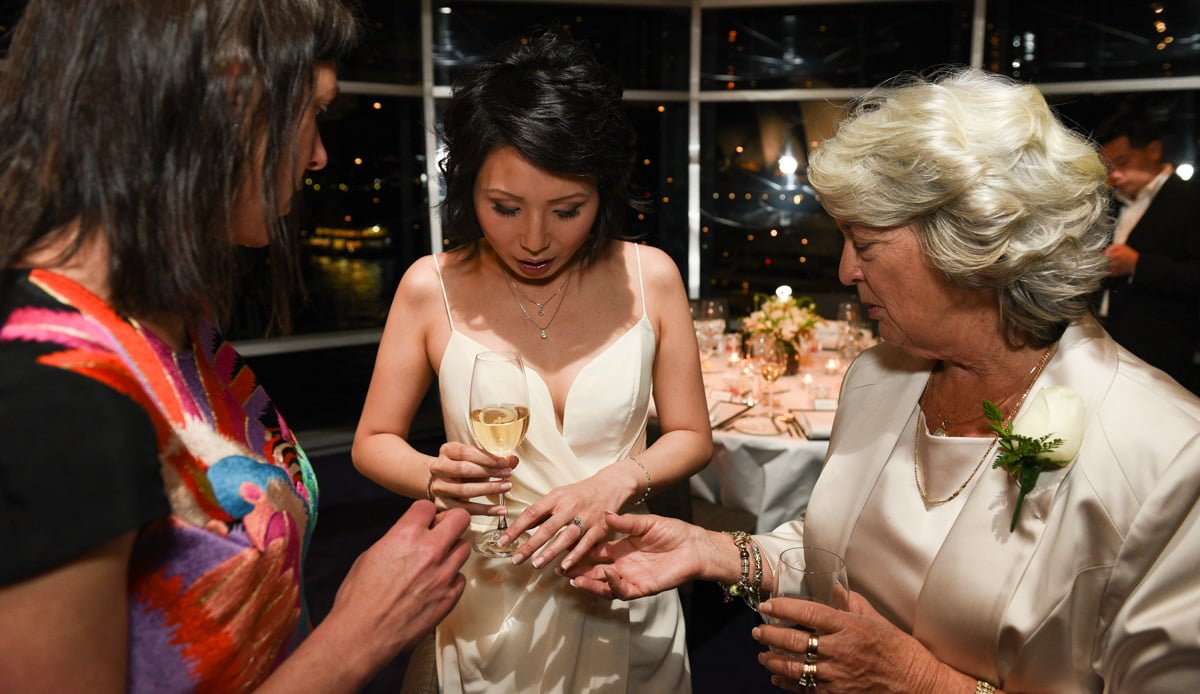 bride showing wedding ring to mother-in-law