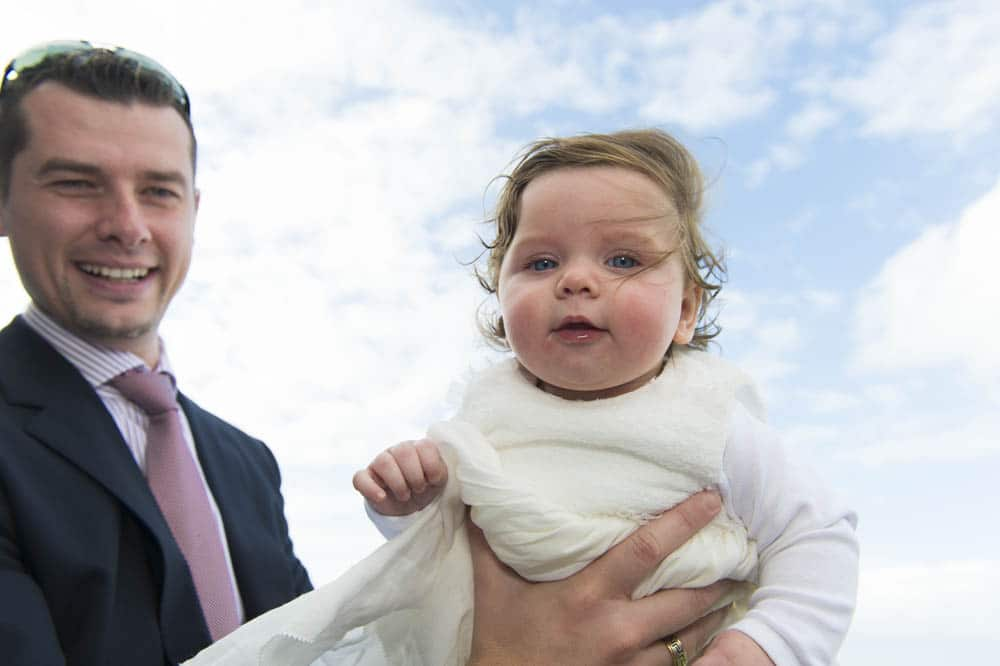 Dad and christening child photographed on balcony of Horizons Function