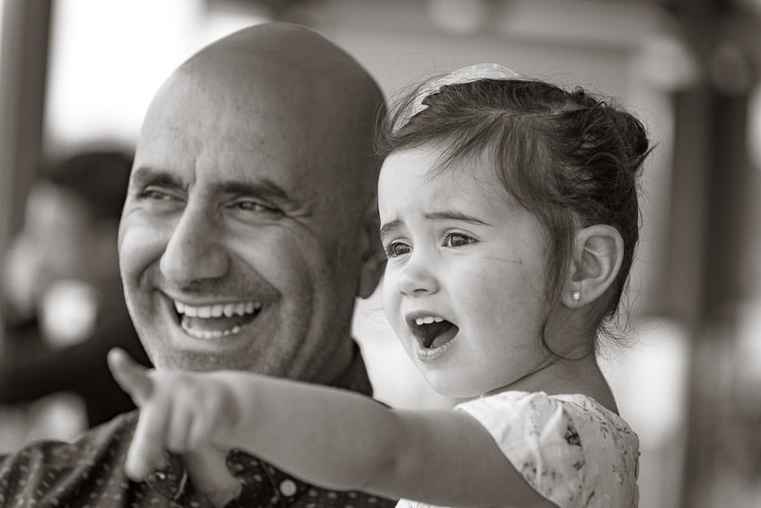 Grandfather and grand daughter photographed on the balcony of St George Motor Boat Club