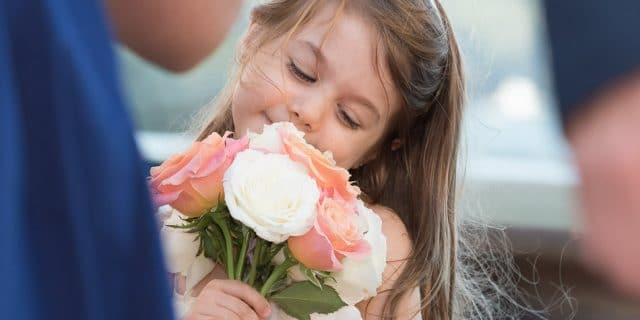 little girl smiling flowers