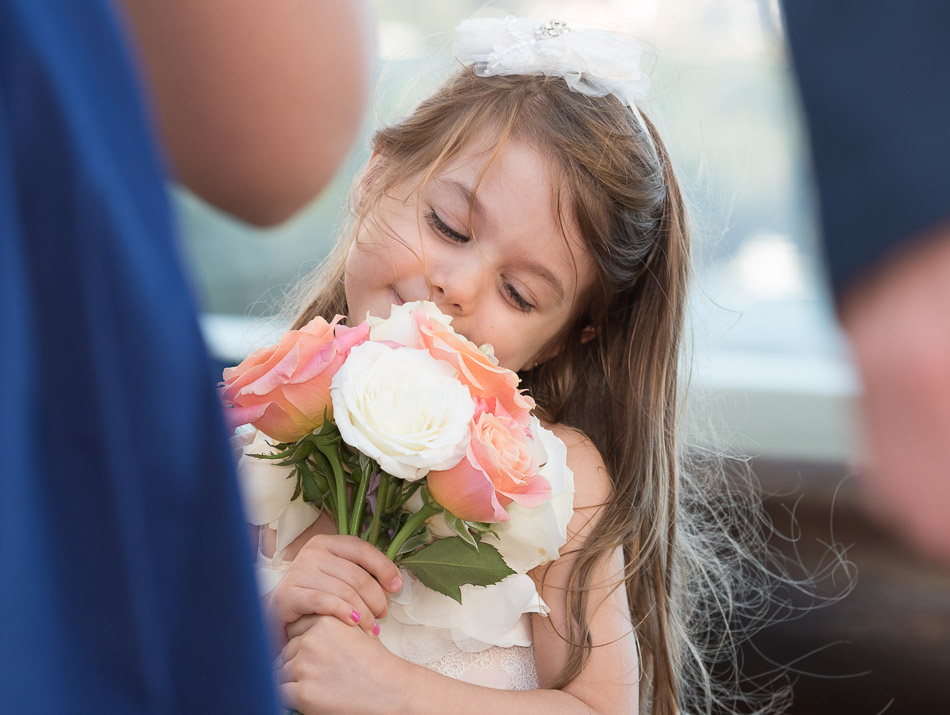 little girl smiling flowers at Balmoral Bathers Pavilion